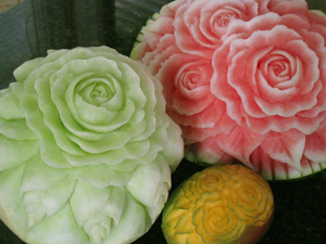 roses carved into honeydew, watermelon and mango