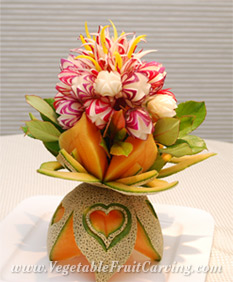 Radish flower bouquet in cantaloupe vase