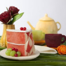carved tea set with watermelon cake