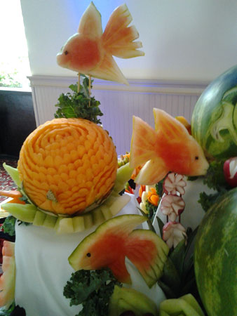 fish fruit carvings by Yolanda Diaz