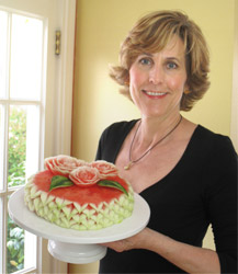 NIta Gill with watermelon cake topped with watermelon roses