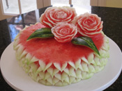 watermelon cake topped with watermelon roses
