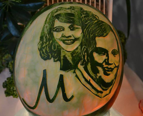 carved portraits on watermelon for wedding rehearsal dinner
