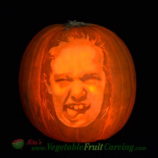 one of the silly faces carved on pumpkins