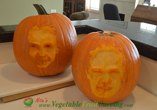 faces carved on pumpkins in daylight