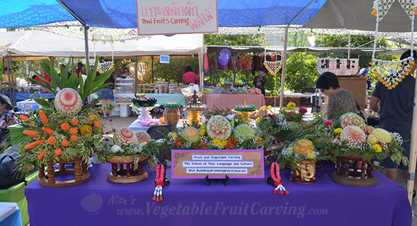 Loy Krathong fruit carving booth features Thai style fruit carving