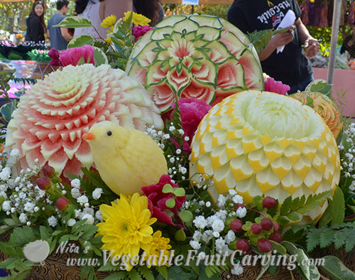 Thai style fruit carvings with bird.