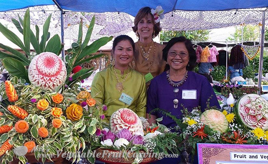 Nujarin, Nita Gill, and Tym at Thai Carving Booth