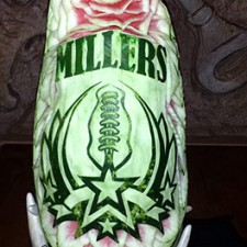 bold football themed watermelon carving