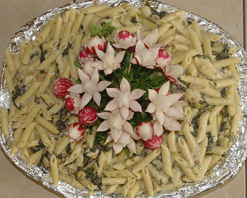 radish bouquet garnish in penne paste