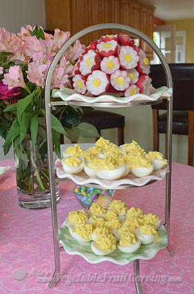 Easter garnishes - radish bouquet and deviled eggs.