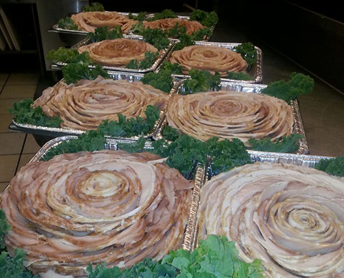 Caterer George Reed's sliced meat roses