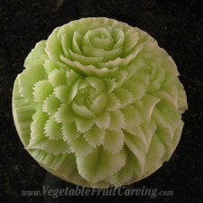 Nita's honeydew carving with jagged petals