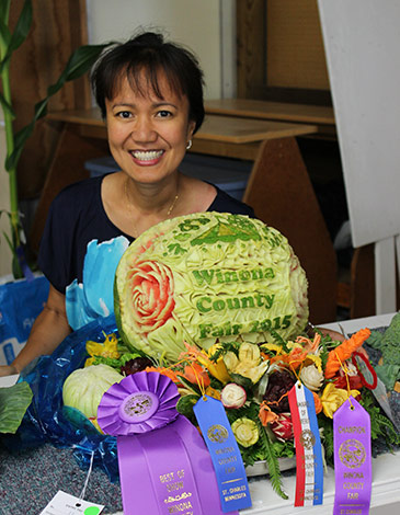 carving competition winner  Josephine Schloegel paricipate in vegetable carving competitions