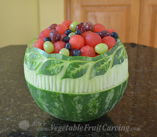 Stripes carved into Nita's leaf pattern watermelon bowl.