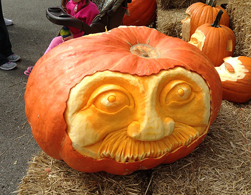mustached man pumpkin face