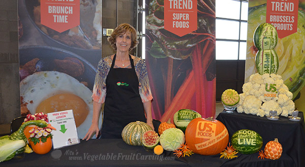 "Nita Gill with her carvings at US. Foods ""Food Fanatics Live"" event"