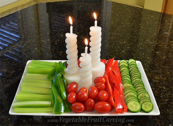 vegetable candles in vegetable tray