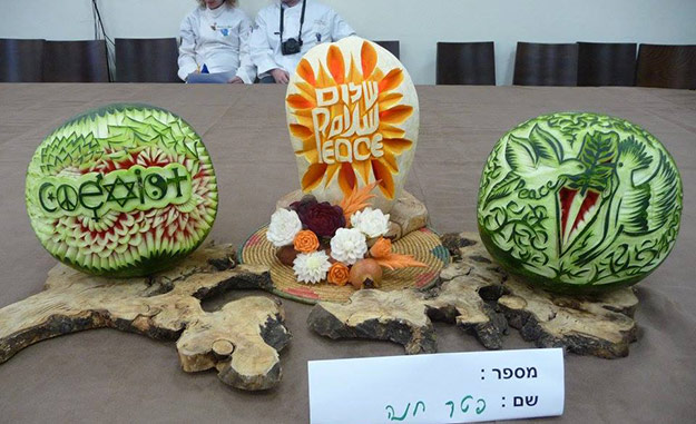 winning fruit carving display at the International Peace Day Championships competition