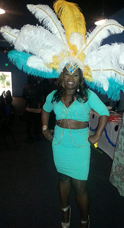 Kentrina in feathered Mardi Gras headdress