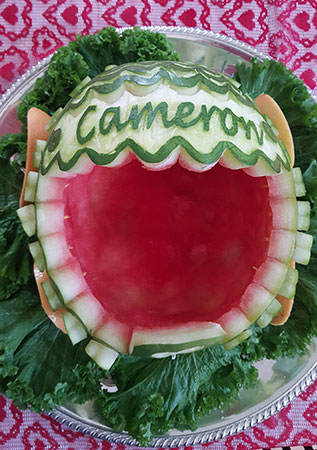 bonnet of watermelon carriage carved with baby's name