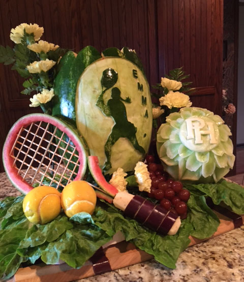 tennis themed fruit display at graduation party