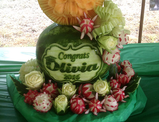 close up of watermelon graduation party decorations