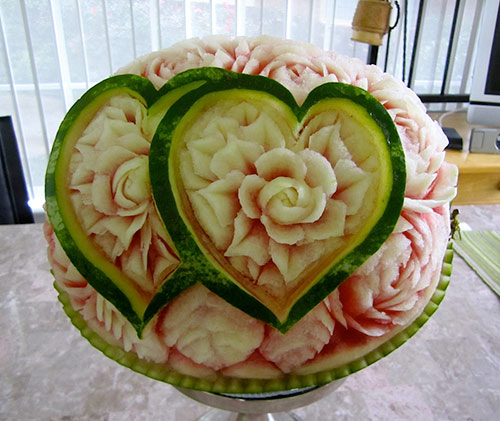 watermelon carved with double hearts filled with roses by Rani Patel.