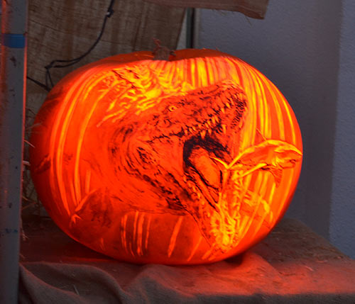 A shark eating a shark carved pumpkin