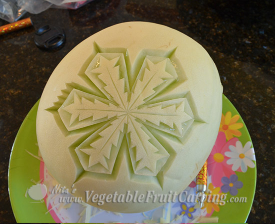step 3 of melon snowflake carving