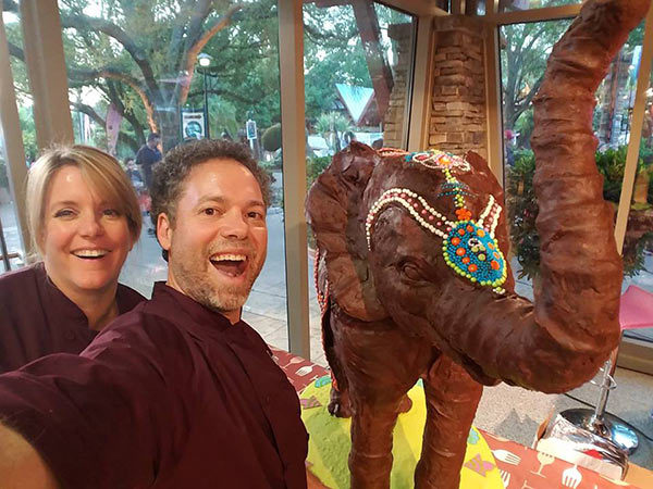 Michelle Boyd and Paul Joaquim with thier elephant made of chocolate