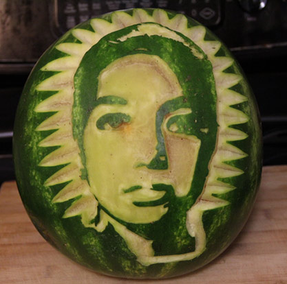 Face carved onto watermelon by Lino Hermano