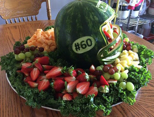 watermelon football helmet with player number