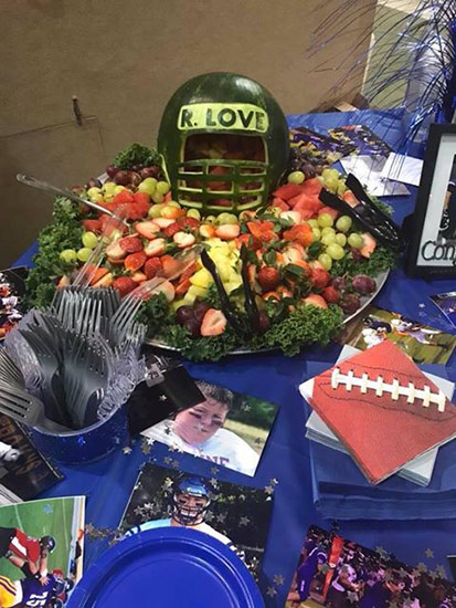 watermelon football helmets on memorabilia table decorate the fruit tray