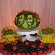 wedding couple faces carved on watermelon