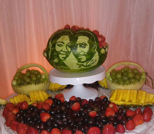 wedding couple's faces carved on watermelon
