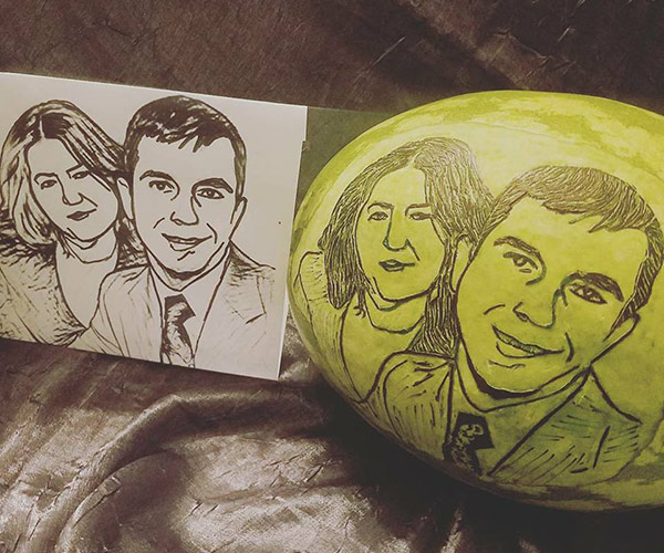 faces carved on watermelons for wedding anniversary by Svetlana Partem