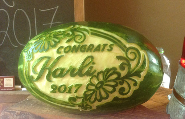 """Congrats"" graduation melon carving by Cindy Rozich"