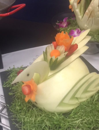 honeydew swan with added flowers by Susie Lombardo