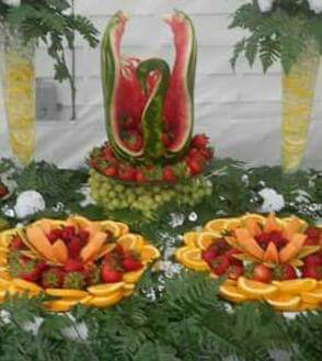Large watermelon swan centerpiece on fruit table