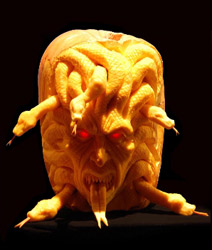 Snake head pumpkin carving by Ray Villafane